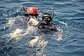 US Navy 110818-N-QL471-314 Rescue Swimmers perform a man overboard drill.jpg