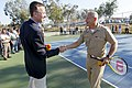 US Navy 110824-N-HW977-264 Steve Kappes, left, and Capt. Terry Auberry shake hands during a ribbon cutting event marking the completion of tennis c.jpg