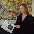 University of Rochester Associate Director of Development Audra Pinkerton holding Rochester Review.JPG