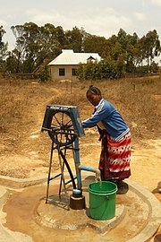 Manual rope pump on a water well head