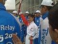 Vanessa Mae holding olympic torch.jpg