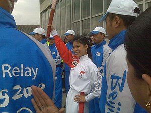 Vanessa-Mae - Vanessa-Mae at the Southbank Centre, London, England, carrying the Olympic torch, April 2008.