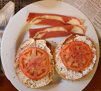 """Vegetarian bacon - Veggie """"bacon"""" breakfast with bagel halves, vegetarian cream cheese, and tomato"""