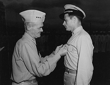 Vice Admiral Marc A. Mitscher decorates Lieutenant Cecil E. Harris on 17 January 1945 (80-G-297413)