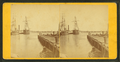 View of pier and ships docked in the harbor, by T. E. M. White.png