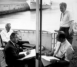 Landor Associates - Walter Landor working on the deck of the Klamath docked in San Francisco Bay (1960s)