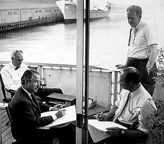 Landor Associates - Walter Landor working on the deck of the Klamath docked in San Francisco Bay (1960s)