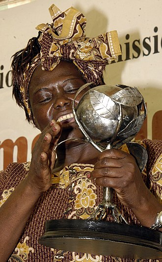 Wangari Maathai - Wangari Maathai holding a trophy awarded to her by the Kenya National Commission on Human Rights