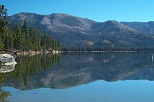 Photo of Warm Lake and surrounding forest and mountains during fall