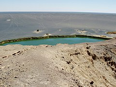 A green lake within a depression