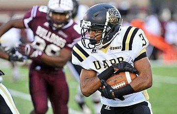 A UAPB player running the football in 2014 Web1 A&M-vs-UAPB8672.jpg