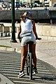 Woman on a bike (49055830038).jpg