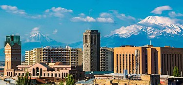 Panoramic view from the Kentron district Yerevan buildings and Ararat.jpg
