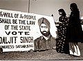 Young female voters reading an election poster for Congress candidate Daljit Singh in Delhi, January 1952.jpg
