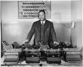 """Cortez W. Peters, World's Champion Portable Typist, is shown with ten late model standard-size typewriters which he tur - NARA - 535804.tif"