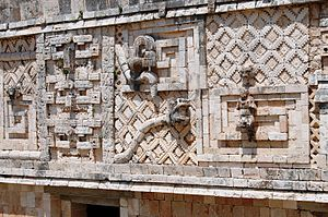 Can Pech - A snake and tick on a wall at Uxmal