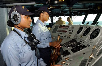 Helmsman - Navy sailors at the helm of an aircraft carrier in December 2001.