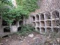 042 Cementiri abandonat de Marmellar, rere l'església, nínxols.JPG