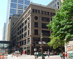 The original Dayton's department store in downtown Minneapolis, today. A bronze statue of Mary tossing her hat in the air stands in the foreground at the corner where it occurred.