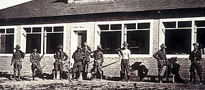 Glenn Springs raid - Nine men of the 14th Cavalry in front of the Ellis home at Glenn Springs, Texas in 1916.