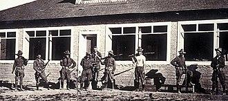 Glenn Springs raid - Nine men of the 14th Cavalry in front of the Ellis home at Glenn Springs, Texas in 1916.