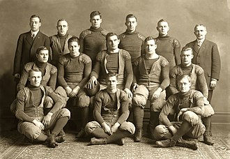 Maurice E. Crumpacker - Crumpacker (middle row, second from left) was the starting right tackle for the 1908 Michigan Wolverines football team