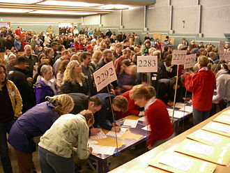 United States presidential primary - Voters checking in at a 2008 Washington State Democratic caucus held at the Nathan Eckstein Middle School in Seattle