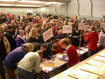 Voters checking in at a 2008 Washington State Democratic caucus held at the Nathan Eckstein Middle School in Seattle 2008 Wash State Democratic Caucus 03.jpg