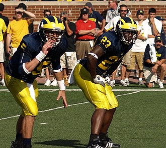 Carlos Brown (American football) - Tate Forcier calling signals in the backfield with Brown during the 2009 Michigan–Notre Dame game.