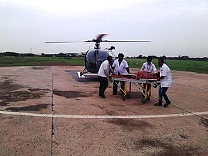 2017 Gujarat flood - Medics transporting rescued person