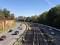 2018-10-25 12 06 18 View east along Interstate 66 (Custis Memorial Parkway) and the Orange and Silver lines of the Washington Metro from the overpass for North Harrison Street in Arlington County, Virginia.jpg