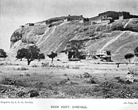 image of a rocky hill with a fort above it