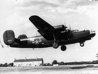 "RAF Harrington - A B-24 Liberator (serial number 42-51211) nicknamed ""Miss Fitts"" takes off from Harrington."
