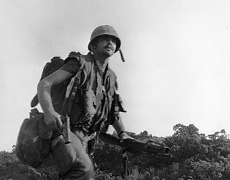 1st Battalion, 5th Marines - Leader of the 1st squad, 3rd Platoon, Company C, 1/5 Marines, runs under Viet Cong fire during Operation Tippecanoe, 14-16 March 1967