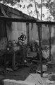 ASC Leiden - NSAG - van Es 2 - 004 - A man working in a workshop for metalworking in the open air - Kampala, Uganda - 29-11-1961 - 4-12-1961.tiff