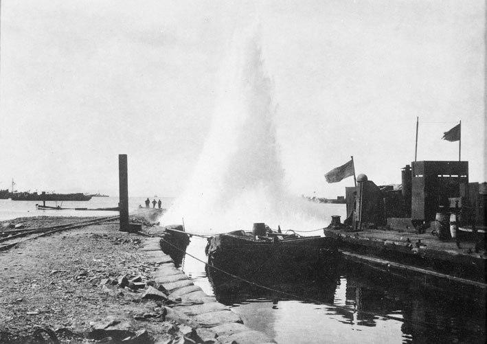 AWM P01326.006 - Turkish shell lands beside a pier, Suvla Bay, October 1915