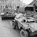 A Humber scout car and Comet tank of 11th Armoured Division in a devastated German town, 30 March 1945. BU2758.jpg