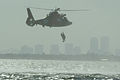 A U.S. Coast Guard MH-65C Dolphin helicopter lowers a rescue swimmer as part of a training evolution on Lake Pontchartrain, La., Jan 120117-G-BD687-003.jpg