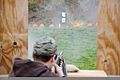 A U.S. Soldier with the Wounded Warrior program sights his shotgun on a pumpkin Nov 111114-A-CP678-100.jpg