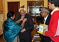 A delegation of All India Federation of the Deaf pinning the flag on the self of Vice President, Mohammad Hamid Ansari on the occasion of the first day of the 49th Flag Week of the Deaf, in New Delhi on February 01, 2008.jpg
