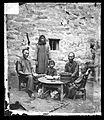 A family eating a meal, Kowloon, John Thomson Wellcome L0056479.jpg