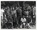 A group of young men hold basketball trophies (12461955885).jpg