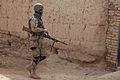 A member of 3rd Kandak, 3rd Brigade, Afghan National Civil Order Police, participates in a dismounted patrol in Sher'Ali Kariz, Maiwand district, Kandahar province, Afghanistan, Feb 120224-A-QD683-059.jpg
