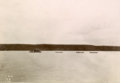 A photograph of the steamer 'Argo' with the three expedition canoes in tow. The photograph was taken on James W. Tyrrell's Great Slave Lake and Hudson Bay Expedition of 1900..png