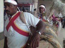 A santal man with his dram-Biplob Rahman.jpg