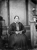 A woman sitting holding flowers NLW3364672.jpg