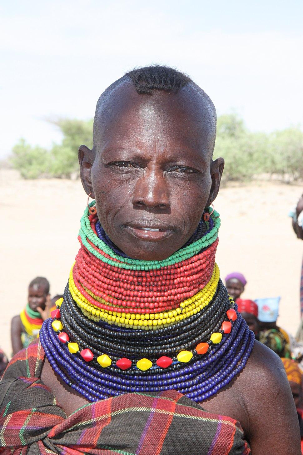 A woman wearing traditional tribal beads in Turkana, Kenya, October 2012 (8405274783)