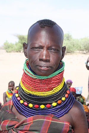 A woman wearing traditional tribal beads in Turkana, Kenya, October 2012 (8405274783)