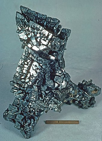 Acanthite sample from the Chispas Mine in Sonora, Mexico; scale at bottom of image as one inch with a rule at one centimetre Acanthite - Chispas Mine, Arizpe, Sonora, Mexico.jpg