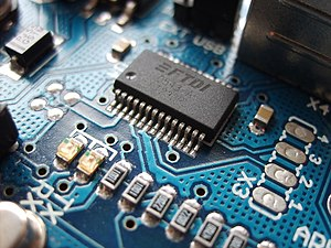 A SMD (surface-mount device) FTDI chip, on the...